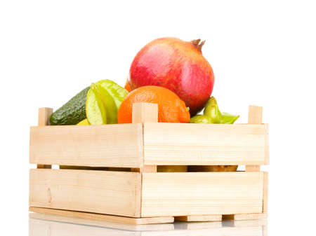 Assortment of exotic fruits in wooden box isolated on white Stock Photo - 12240662