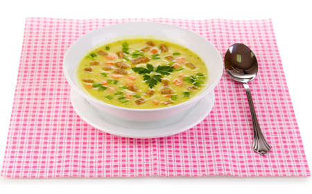 Tasty soup on pink napkin isolated on white photo