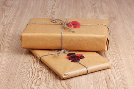 Parcels with sealing wax on wooden background photo