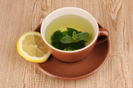 Mint tea with mint leaf and lemon on wooden background Stock Photo - 12240788