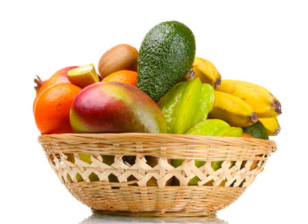 Assortment of exotic fruits in basket isolated on white photo