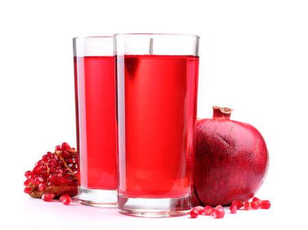 pomergranate: ripe pomergranate and glasses of juice isolated on white