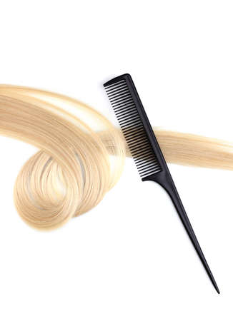 Shiny blond hair and comb isolated on white Stock Photo - 12265589