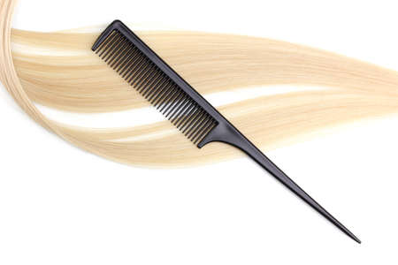 Shiny blond hair and comb isolated on white Stock Photo - 12245239
