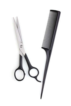 comb hair: Hair cutting shears and comb isolated on white