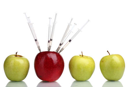 inoculation: juicy apples and syringes isolated on white
