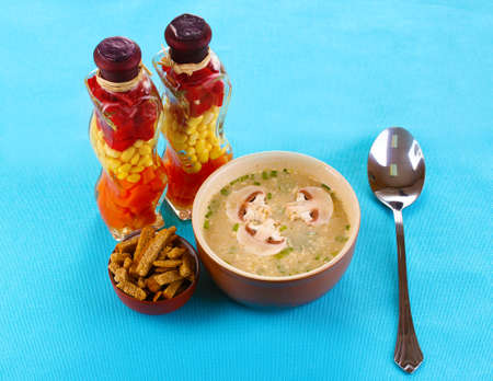 Tasty soup on blue tablecloth photo