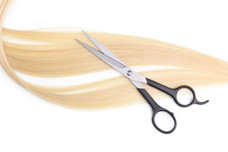 Shiny blond hair and hair cutting shears isolated on white Stock Photo - 12312980