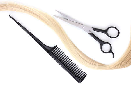 Shiny blond hair with hair cutting shears and comb isolated on white Stock Photo - 12313041