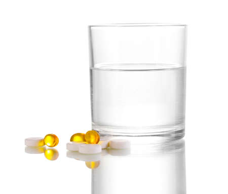 Glass of water and pills isolated on white Stock Photo - 12312233