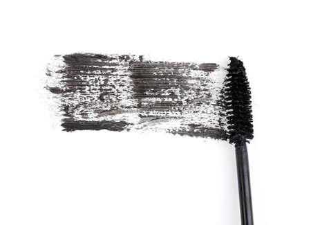 Black mascara brush stroke isolated on white photo