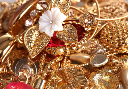 Various gold jewellery closeup photo
