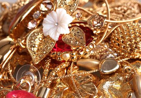 Various gold jewellery closeup photo