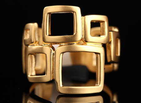 beautiful gold ring on black background Stock Photo - 12313017