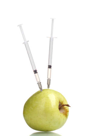fda: green apple and syringes isolated on white