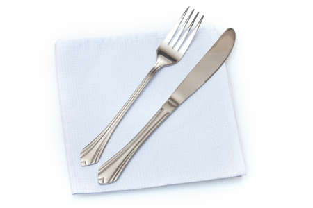 Fork and knife in a blue cloth  isolated on white photo