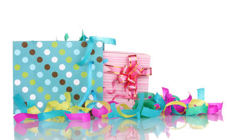 Colorful gift bags and gifts  with serpentine isolated on white photo