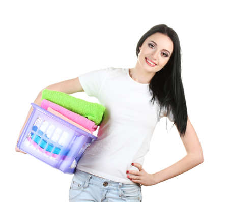 bright housekeeping: beautiful young girl holding basket of laundry isolated on white