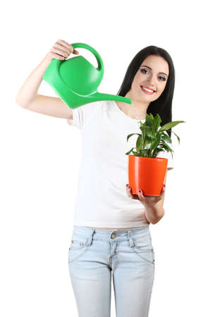 ecologists: beautiful young girl holding home plant and watering can isolated on white Stock Photo