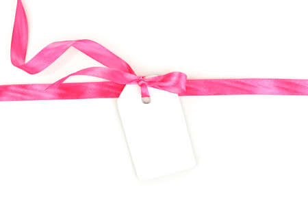pink satin: Blank gift tag with pink satin bow and ribbon isolated on white