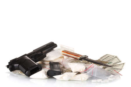 Cocaine and marijuana in packet with gun isolated on white photo