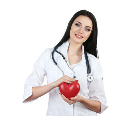 young beautiful doctor with stethoscope holding heart  isolated on white Stock Photo - 12329884