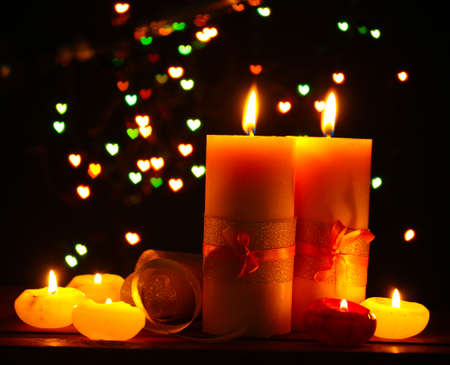 Beautiful candle and decor  on wooden table on bright background photo