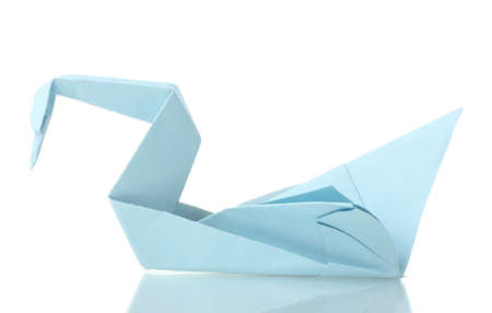 Origami swan out of the blue paper isolated on white photo