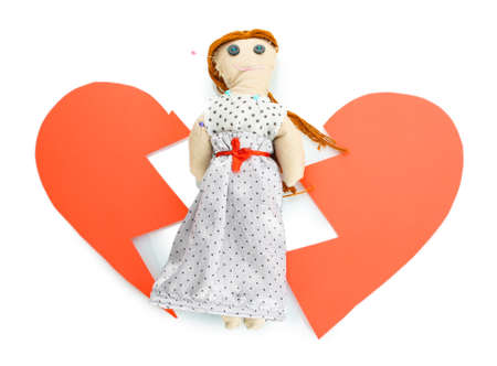 Voodoo doll girl on the broken heart isolated on white Stock Photo