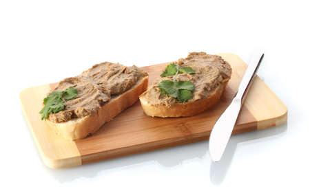 pate: Fresh pate on bread on wooden board isolated on white