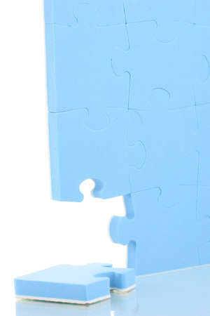 Blue puzzles closeup, isolated on white photo