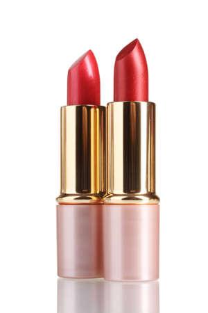 beautiful red lipsticks isolated on white photo