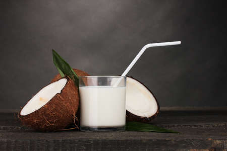 Coconut milk and coconut on grey Stock Photo - 12431282