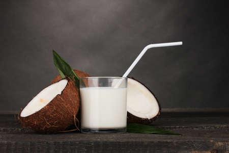 coconuts: Coconut milk and coconut on grey