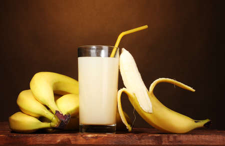 Banana juice with bananas on brown photo