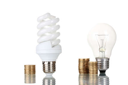 Comparison of ordinary light bulbs with energy saving lamp isolated on white photo