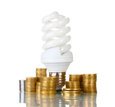 Energy saving lamp and money isolated on white photo