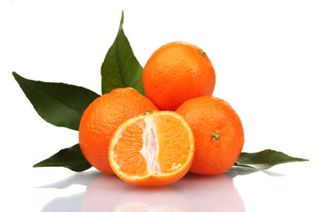Ripe tasty tangerines with leaves and segments isolated on white Stock Photo - 12435348