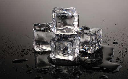 ice cubes: Melting ice cubes on grey background