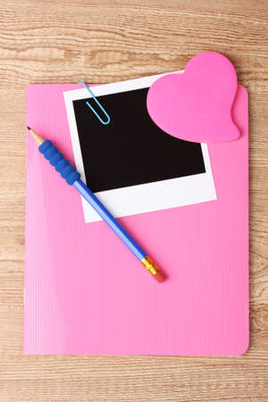 Photo paper and pink notebook on wooden background Stock Photo - 12431024