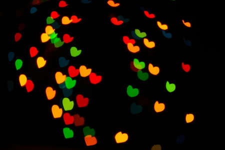 Abstract bright hearts bokeh background  Stock Photo - 12435225