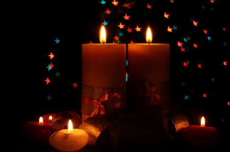 Beautiful candle and decor  on wooden table on bright background Stock Photo - 12435125