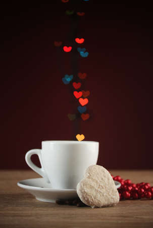 cup of coffee on wooden table on bright bokeh backdground Stock Photo - 12432927