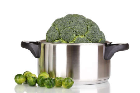 Fresh broccoli in saucepan and brussels sprouts isolated on white Stock Photo - 12436756