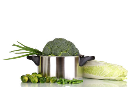 Fresh broccoli in saucepan and cabbages isolated on white photo
