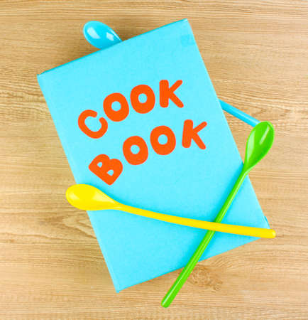 Cookbook and kitchenware on wooden background Stock Photo - 12432178