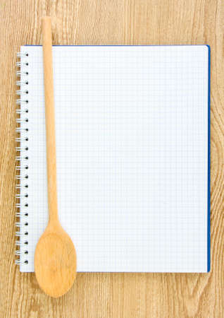cookbook: Open cookbook and kitchenware on wooden background Stock Photo