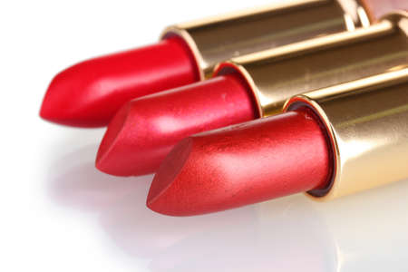 beautiful red lipsticks isolated on white photo