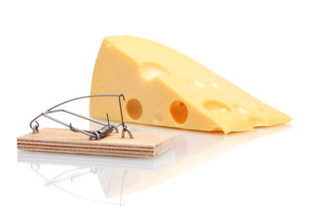 Mousetrap with cheese isolated on white photo