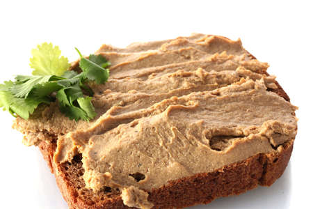 Fresh pate on bread isolated on white Stock Photo - 12546205